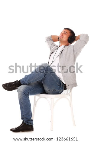 Young caucasian handsome man listening music isolated over white background