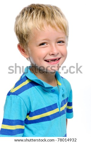 Young caucasian kid smiles for a portrait in studio, isolated on white - stock photo