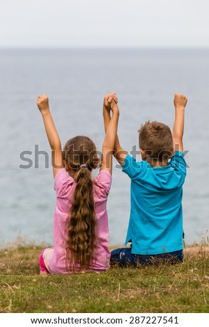 Young caucasian kids in Denmark on a summer day. - stock photo