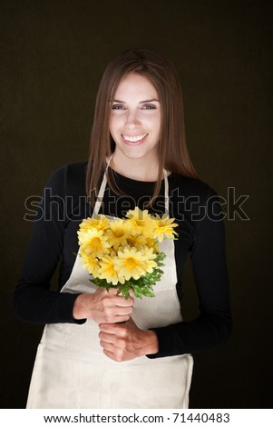 Young caucasian lady holding a bunch of yellow flowers