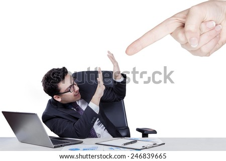 Young caucasian male entrepreneur gets a ridicule from his boss, isolated on white - stock photo