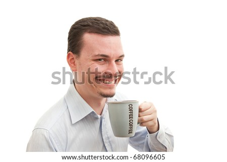 Young caucasian male happily drinking coffee