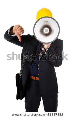 Young caucasian man architect with helmet and briefcase on shoulder. Megaphone in front face and thumb down. Studio shot. White background. - stock photo