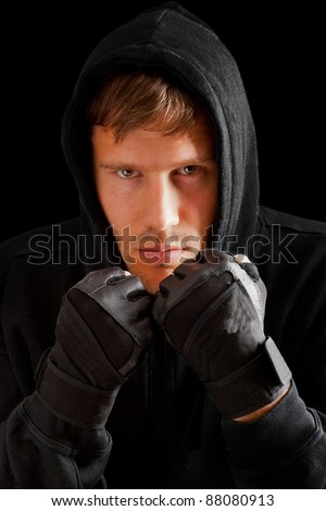 Young caucasian man boxing;  defense position; isolated on black background - stock photo