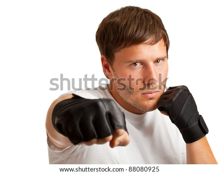 Young caucasian man boxing; isolated on white background - stock photo