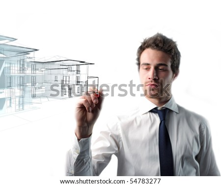 young caucasian man drawing house - stock photo