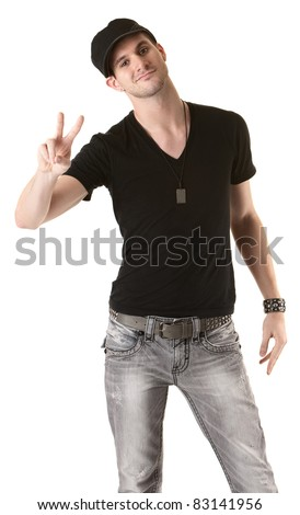 Young Caucasian man gestures victory sign over white background