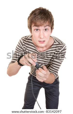 Young Caucasian man holds video game controller over white background - stock photo