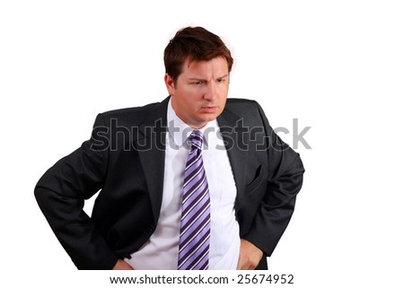Young caucasian man in a suite looking angry - stock photo
