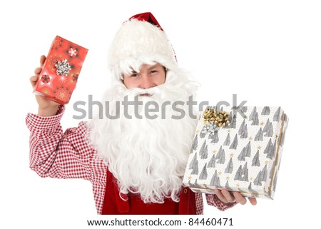 Young caucasian man in Santa Claus clothes holding gifts. Studio shot. White background. - stock photo