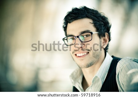 Young caucasian man portrait outdoor - stock photo