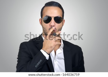 Young Caucasian man smoking cigar