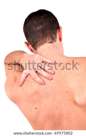 young caucasian man with pain in a back isolated on white - stock photo