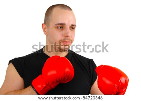 Young caucasian man with red box gloves on white background