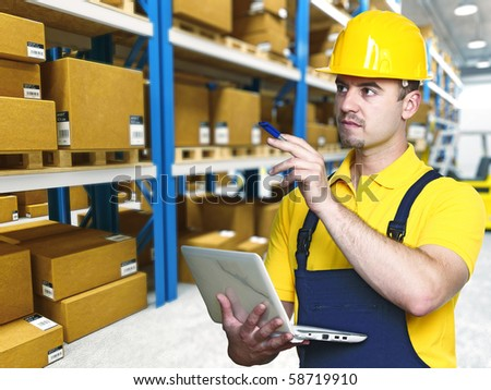 young caucasian manual worker in classic warehouse - stock photo