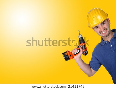 young caucasian manual worker with  drill background