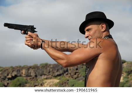 Young Caucasian Muscular Tanned Man in the Desert Tenerife Spain - stock photo