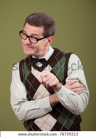 Young Caucasian nerd pointing index finger on green background - stock photo