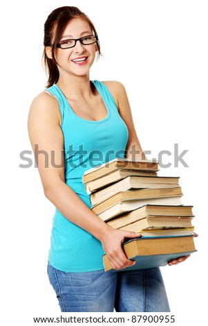 Young caucasian schoolgirl smiling and holding many books. Isolated on white. - stock photo