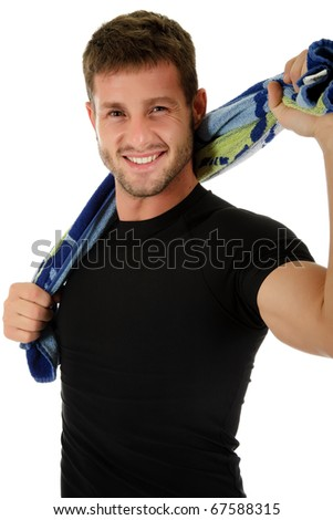 Young caucasian sporty man with towel on shoulder. Happy and invigorated look. Studio shot. White background - stock photo