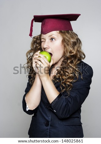 Young caucasian student eating an apple