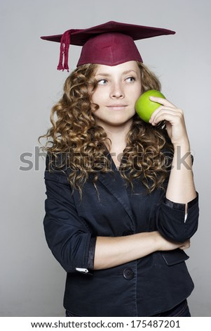 Young caucasian student with an apple - stock photo