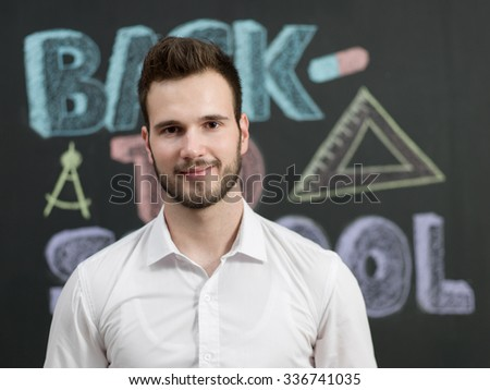 young caucasian teacher at school - stock photo