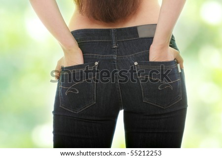 Young caucasian woman body in jeans - stock photo