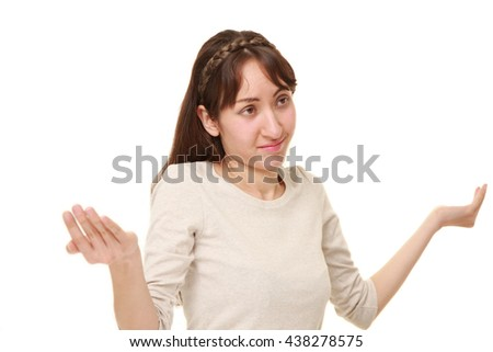 young caucasian woman confused - stock photo