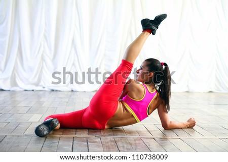 Young caucasian woman dancer is posing - stock photo