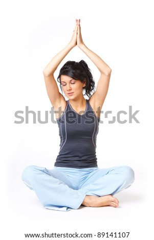 Young caucasian woman doing yoga exercise, isolated on white background - stock photo