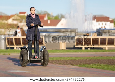 Young caucasian woman during segway city tour - stock photo