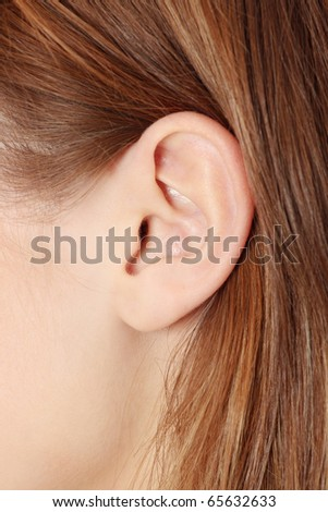 Young caucasian woman ear closeup. - stock photo