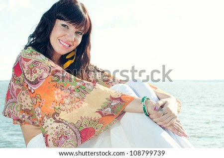 Young caucasian woman enjoying summer time, looking rested and relaxed - stock photo