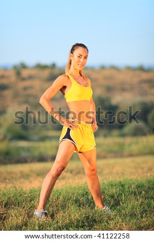 Young Caucasian woman exercising outdoor - stock photo