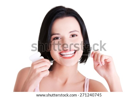 Young caucasian woman flossing her teeth.