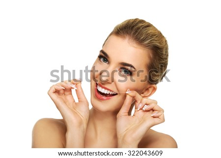 Young caucasian woman flossing her teeth, isolated on white - stock photo