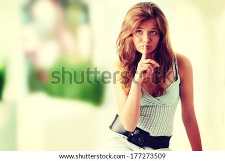 Young caucasian woman gesturing silence - stock photo