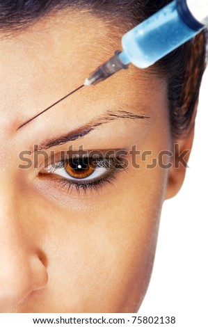 Young caucasian woman getting an injection, close up