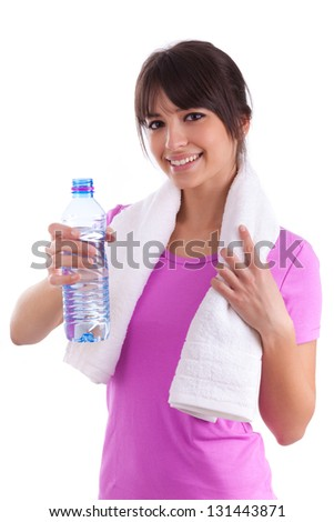 Young caucasian woman holding a bottle of water  over white background - stock photo