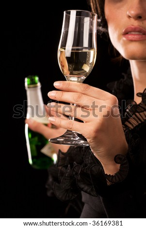 Young caucasian woman holding a champagne bottle and glass