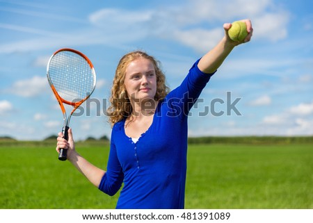 Young caucasian  woman holding tennis racket and tennis ball outside