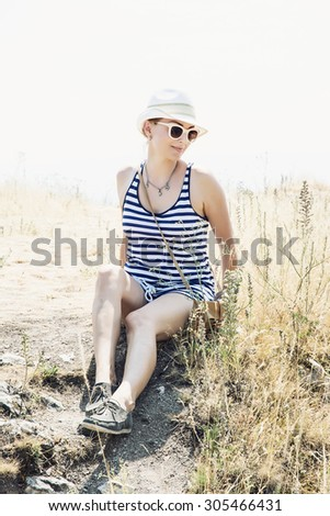 Young caucasian woman in a sailor outfit posing in outdoor. - stock photo