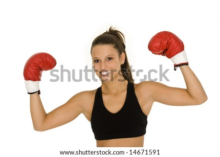 Young Caucasian woman in red boxing gloves showing a sign of victory