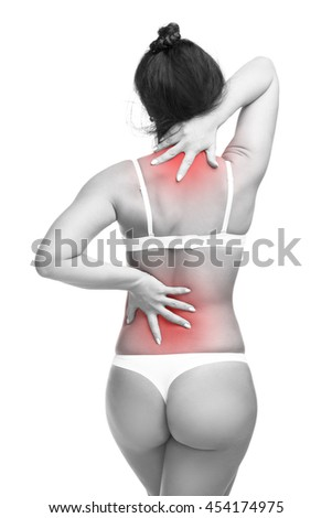 Young caucasian woman in underwear with backache, neck pain in the female body, isolated on white background with red dot, copy space - stock photo