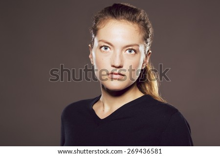 Young Caucasian woman looking at viewer with neutral expression - stock photo