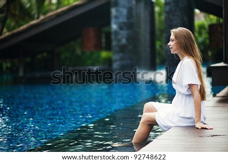 Young caucasian woman near swimming pool - stock photo