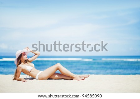 Young caucasian woman on the beach, bali - stock photo