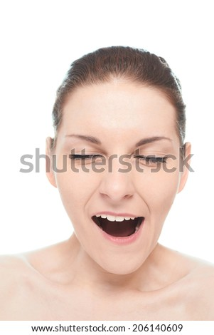 Young caucasian woman portrait with a yawning facial expression, isolated over the white background, natural make up and postprocessing - stock photo