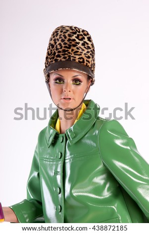 Young caucasian woman posing, isolated over white, retro styling - stock photo